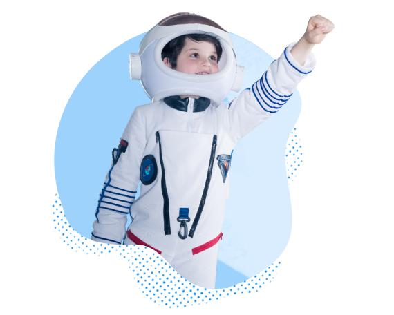 smiling child in space suit raising fist into the air